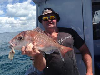 Another proud customer posing with a snapper