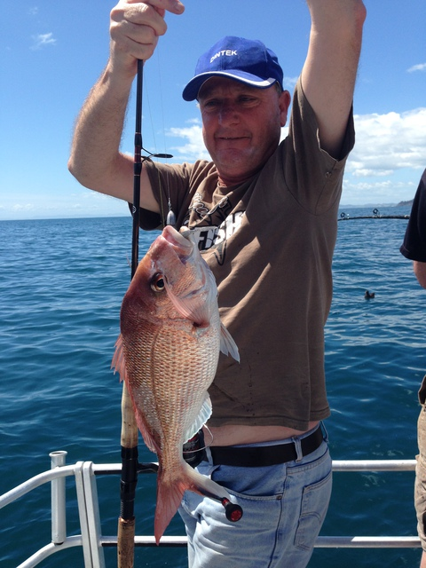 Excited Customer holds up a snapper