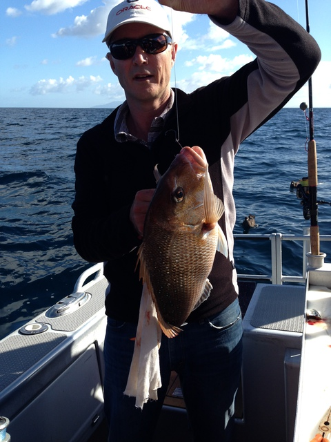 Jigging for Snapper in the deep